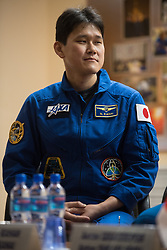 Expedition 54 flight engineer Norishige Kanai of Japan Aerospace Exploration Agency (JAXA) is seen in quarantine, behind glass, during a press conference, Saturday, December 16, 2017 at the Cosmonaut Hotel in Baikonur, Kazakhstan. Expedition 54 Soyuz Commander Anton Shkaplerov of Roscosmos, flight engineer Scott Tingle of NASA, and flight engineer Norishige Kanai of Japan Aerospace Exploration Agency (JAXA) are scheduled to launch to the International Space Station aboard the Soyuz spacecraft from the Baikonur Cosmodrome on December 17. Photo by Joel Kowsky / NASA via CNP/ABACAPRESS.COM