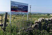 An idyllic landscape of grazing sheep in green fields and farmland that will soon change forever when it will be built upon by housing developer Taylor Wimpey at Netherton Grange, Youngwood Lane, Nailsea, on 31st May 2021, in Nailsea, North Somerset, England. Nearly 170 homes are set to be built here on the edge of Nailsea after detailed plans were approved. Thirty per cent of the homes will be affordable.