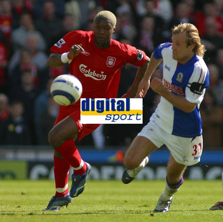Photo: Paul Thomas.<br /> Blackburn Rovers v Liverpool. The Barclays Premiership. 16/04/2006.<br /> <br /> Liverpool's Djibril Cisse and Blackburn's Michael Gray chase the ball.