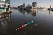 People training rowing on the canals of the MediaCityUK in Manchester, UK.