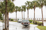 Vehicles pass through floodwaters along Murray Blvd in the historic district after record breaking storms dumped more than two feet of rain on the lowcountry October 5, 2015 in Charleston, South Carolina.