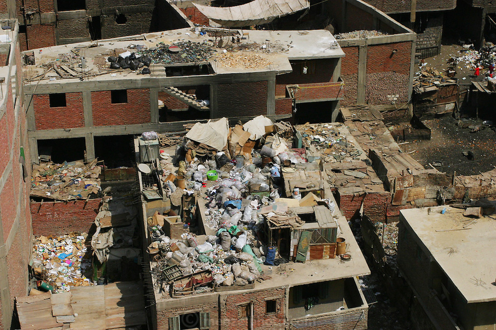 Zabaleen neighborhood rooftops in Cairo, Egypt. The Zabaleen districts (garbage collectors in Arabic) are home to the huge recycling industry run by the garbage collectors and their families. They recycle up to 87% of the trash they collect. The organic garbage is used to raise pigs and goats in their neighborhood.