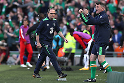 Republic of Ireland manager Martin O'Neill (left) and Assistant manager Roy Keane celebrates their side's first goal of the game during the 2018 FIFA World Cup Qualifying, Group D match at the Aviva Stadium, Dublin.