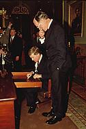 Washington DC 1989/02/01 President  Herbert Walker Bush watches VP Quayle sign desk<br />Photo by Dennis Brack