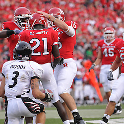 Sep 7, 2009; Piscataway, NJ, USA;  Rutgers cornerback Devin Mccourty (21) is cheered by teammates after making a play on a punt during the second half as Cincinnati defeats Rutgers 47-15 in NCAA Big East football at Rutgers Stadium.