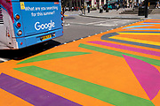 """An ad for Google appears on the rear of a London bus, asking the question """"What are you searching for this summer?"""", as it drives over the multi-coloured markings of a crossing at Piccadilly Circus, on 16th July 2021, in London, England."""