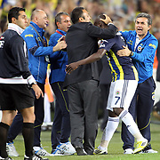 Fenerbahce's celebrates his goal Moussa Sow, Aykut Kocaman (L-R) during their Turkish Superleague soccer derby match Fenerbahce between Besiktas at Sukru Saracaoglu stadium in Istanbul Turkey on Sunday 07 October 2012. Photo by TURKPIX