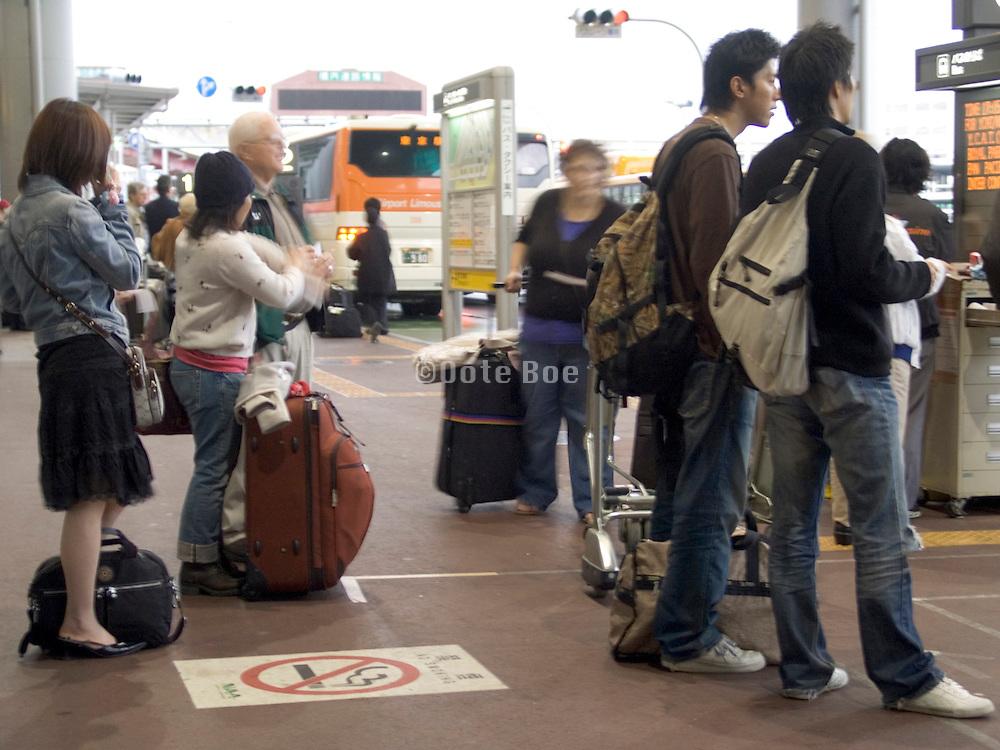 passengers waiting for bus transportation at Narita International Airport Tokyo