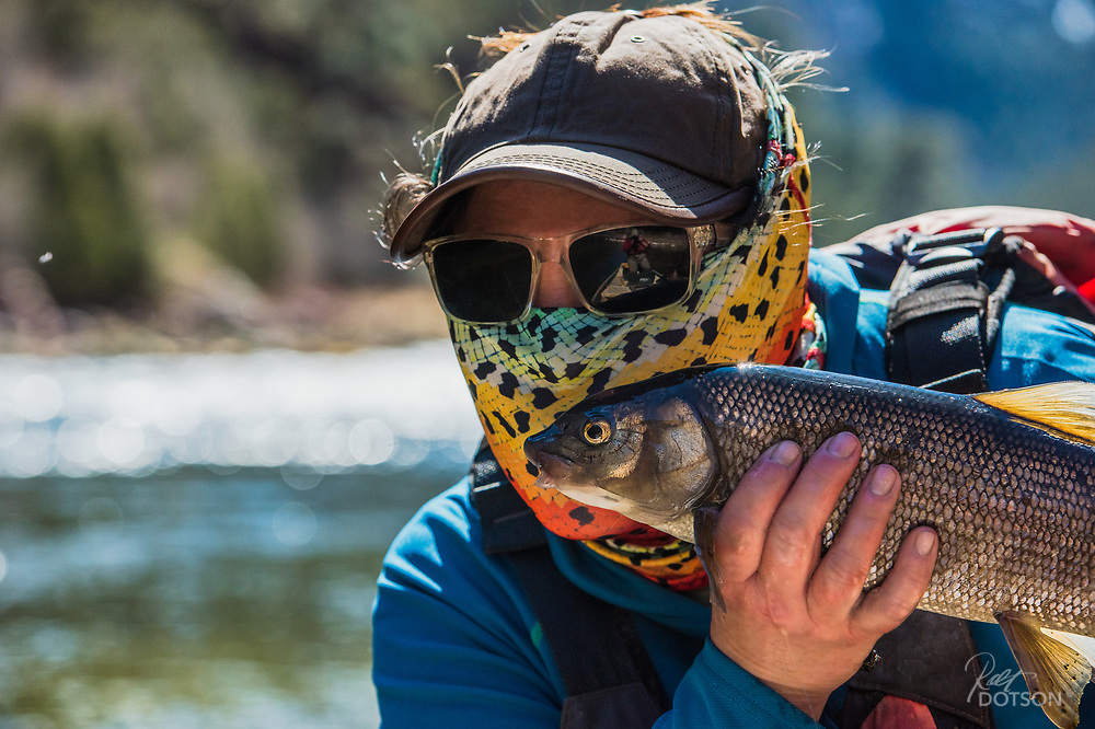 A lucky smootch, with lip protection of course, gets put on a sizable whitefish.