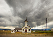 The catholic church is quiet on a late summer midday in Leadore, Idaho. That is soon to change with massive thunderheads entering the valley.