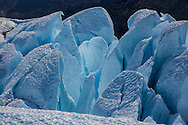 Close up photo of a deep blue glacier