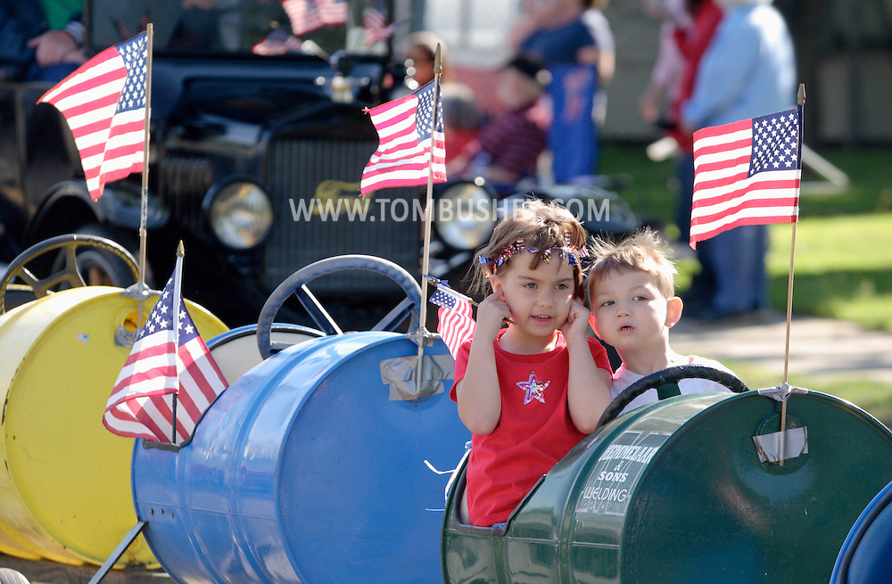 Middletown, NY - Two children ride in the Middletown-Wallkill Veterans Council Memorial Day parade on May 26, 2008.