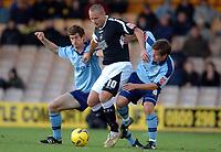 Photo: Paul Greenwood.<br />Port Vale v Swansea City. Coca Cola League 1. 18/11/2006. Swansea's Lee Trundle, centre, battles with George Pilkington, left and Paul Harsley.