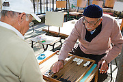 Israel, Haifa, Wadi Nisnas, two mature men playing backgammon