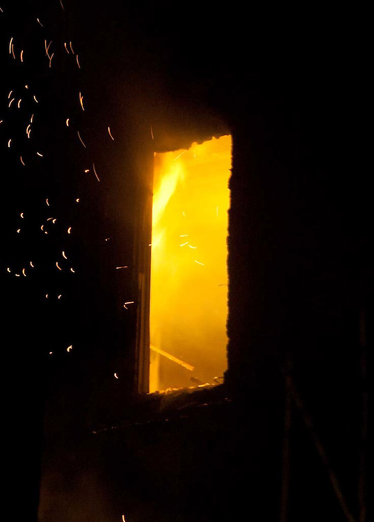 Somerville, MA 02/06/2012.Flames burn inside a house on Jacques St. on Monday evening..Wicked Local Photo by Alex Jones