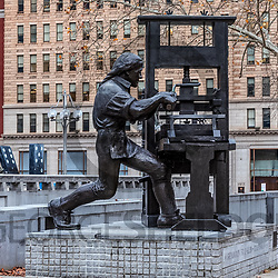 Philadelphia, PA, USA - January 1, 2016: Sculpture of Benjamin Franklin at the printing press in Philadelphia.