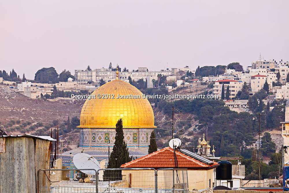 The golden Dome of the Rock is visible across rooftops of the Jewish Quarter of the Old City of Jerusalem. WATERMARKS WILL NOT APPEAR ON PRINTS OR LICENSED IMAGES.