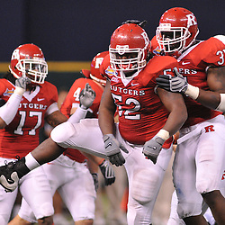 Dec 19, 2009; St. Petersburg, Fla., USA; Rutgers defensive end Eric Legrand (52) celebrates a sack with defensive end George Johnson (31) during NCAA Football action in Rutgers' 45-24 victory over Central Florida in the St. Petersburg Bowl at Tropicana Field.
