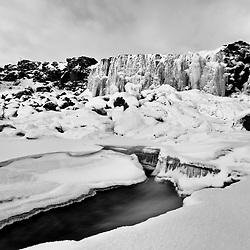 The waterfall Oxararfoss covered with ice, Iceland - Öxarárfoss í klakaböndum