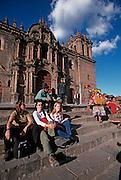 PERU, HIGHLANDS, CUZCO foreign students in the Plaza de Armas
