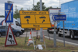 © Licensed to London News Pictures. 28/07/2015<br /> Operation Stack chaos at Junction 8 of the M20 in Kent.<br /> <br /> Operation stack is back on the M20 in Kent.<br /> Just days after Operation Stack was taken off the M20, it was brought back in the early hours of this morning.<br /> The authorities are blaming a heavy volume of traffic heading towards the Port of Dover and Eurotunnel and the continued disruption in Calais.<br /> The coast-bound carriageway between junctions 8 and 9 is closed to allow lorries to park, but the slip roads at junctions 9, 10 and 12 and 13 have also been shut. <br /> <br /> (Byline:Grant Falvey/LNP)