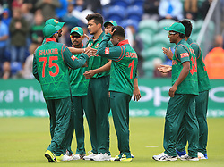 Bangladesh's Taskin Ahmed (centre) celebrates after taking the wicket of New Zealand's Luke Ronchi during the ICC Champions Trophy, Group A match at Sophia Gardens, Cardiff.