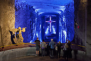 Tourists in the Salt Cathedral of Zipaquira is an underground Roman Catholic Church / Cathedral, built 200m down in the tunnels of a salt mine, in a village called Zipaquira, in Cundinamarca, on the outskirts of Bogota, Colombia. Crosses and other religious ornaments have been hand carved out of salt.