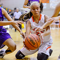Gallup Bengal McKleigh Begaye (25) drops to the floor to grab the ball away from Miyamura Patriot Tonya Tolina (34) Monday at Gallup High School.