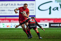 Scarlets' Hadleigh Parkes is tackled by Dragons' Sarel Pretorius<br /> <br /> Photographer Craig Thomas/Replay Images<br /> <br /> Guinness PRO14 Round 13 - Scarlets v Dragons - Friday 5th January 2018 - Parc Y Scarlets - Llanelli<br /> <br /> World Copyright © Replay Images . All rights reserved. info@replayimages.co.uk - http://replayimages.co.uk