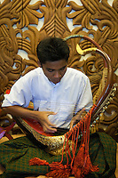 Playing Burmese Harp - Also known a Myanmar harp, the Saung Gauk is the national musical instrument of Burma, with an ancient harp tradition known to be the only surviving harp in Asia.