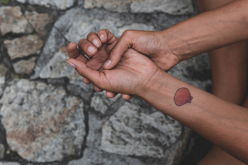 Alice, from England, with a fresh tattoo made after completing the Camino in Santiago de Compostela, Spain. (July 12, 2018)