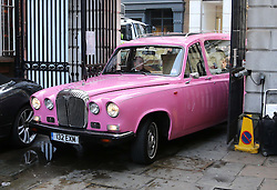 A pink hearse carrying the body of Only Fools and Horses actor  Roger Lloyd-Pack who played Trigger in the TV show, arriving for his funeral at St.Paul's Church in  London, Thursday, 13th February 2014. Picture by Stephen Lock / i-Images