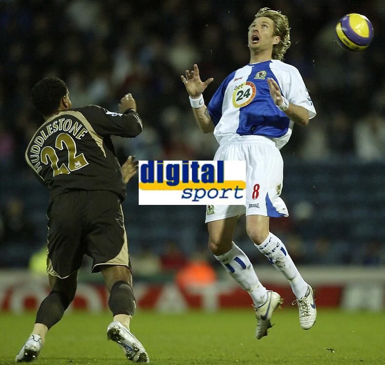 Photo: Aidan Ellis.<br /> Blackburn Rovers v Tottenham Hotspur. The Barclays Premiership. 19/11/2006.<br /> Spurs Tom Huddlestone lobs the ball over Blackburn's Robbie Savage
