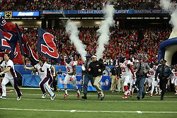 Dec 31, 2014; Atlanta , GA, USA; Mississippi Rebels and head coach Hugh Freeze take the field prior to facing the TCU Horned Frogs in the 2014 Peach Bowl at the Georgia Dome. Mandatory Credit: Kevin Liles/CFA Peach Bowl via USA TODAY Sports