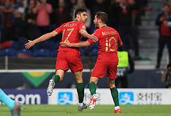 Portugal's Goncalo Guedes celebrates scoring his side's first goal of the game with team-mate Bernardo Silva during the Nations League Final at Estadio do Dragao, Porto.