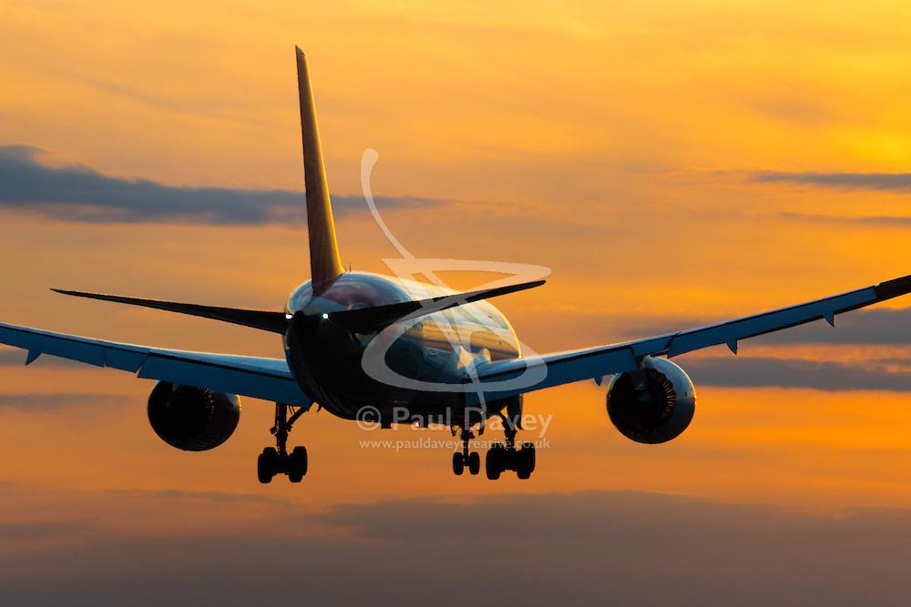 London Heathrow, September 19th 2015. A boeing 787 lands as the sun sets on Heathrow Airport's runway 27R.
