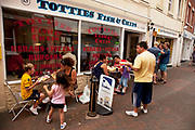 Tottiew Fish and Chip shop. Cowes is an English seaport town on the Isle of Wight. Cowes has been seen as a home for international yacht racing since 1815. The town gives its name to the world's oldest regular regatta, Cowes Week, which occurs annually in the first week of August.