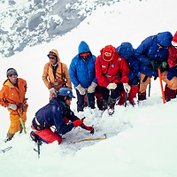 Pertemba Sherpa teaches his colleagues how to make an ice anchor at an early mountaineering school for sherpas in the Khumbu region of Nepal, 1980.