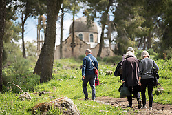 15 March 2019, Ma'alul: A group of ecumenical accompaniers ascend the hill in Ma'alul. In 1948, apple trees used to grow here, as a source of food and income for the villagers of Ma'alul. Since the land was occupied, a pine tree forest has been planted to replace the fruit trees. Ma'alul, a Palestinian village destroyed in the 1948 Arab-Israeli war, sees a visit by ecumenical accompaniers from the World Council of Churches Ecumenical Accompaniment Programme in Palestine and Israel.