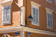 Traditional lanterns and window shutters in street scene in Old Town of Kerkyra, Corfu Town, Greece