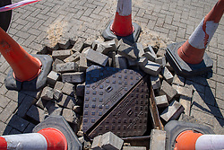 © Licensed to London News Pictures. 06/05/2020. Woolton Hill, UK. A manhole cover made up of bricks and metal coverings is cordoned off, during the fire it was reported by local residents that an explosion was heard from or causing the cover to be destroyed. A fire has destroyed two houses on Woolton Lodge Gardens, Woolton Hill in Hampshire. The fire started approximately 20:10 BST on Tuesday 05/05/2020. Photo credit: Peter Manning/LNP