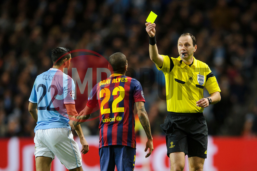 Barcelona Defender Daniel Alves (BRA) is shown a yellow card by referee Jonas Eriksson (SWE) - Photo mandatory by-line: Rogan Thomson/JMP - Tel: 07966 386802 - 18/02/2014 - SPORT - FOOTBALL - Etihad Stadium, Manchester - Manchester City v Barcelona - UEFA Champions League, Round of 16, First leg.