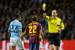 Barcelona Defender Daniel Alves (BRA) is shown a yellow card by referee Jonas Eriksson (SWE) - Photo mandatory by-line: Rogan Thomson/JMP - Tel: 07966 386802 - 18/02/2014 - SPORT - FOOTBALL - Etihad Stadium, Manchester - Manchester City v Barcelona - UEFA Champions League, Round of 16, First leg.
