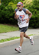Middletown, New York - A runner races to the finish line in the 15th annual Ruthie Dino Marshall 5K Run and Fun Walk hosted by the Middletown YMCA on Sunday, June 5, 2011. ©Tom Bushey / The Image Works