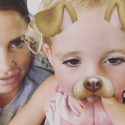 """Katie Price releases a photo on Instagram with the following caption: """"Kids so funny \ud83d\ude02"""". Photo Credit: Instagram *** No USA Distribution *** For Editorial Use Only *** Not to be Published in Books or Photo Books ***  Please note: Fees charged by the agency are for the agency's services only, and do not, nor are they intended to, convey to the user any ownership of Copyright or License in the material. The agency does not claim any ownership including but not limited to Copyright or License in the attached material. By publishing this material you expressly agree to indemnify and to hold the agency and its directors, shareholders and employees harmless from any loss, claims, damages, demands, expenses (including legal fees), or any causes of action or allegation against the agency arising out of or connected in any way with publication of the material."""
