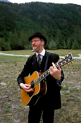 AK: Skagway, Alaska, Entertainer Steve Hite     Photo Copyright: Lee Foster, lee@fostertravel.com, www.fostertravel.com, (510) 549-2202.Image: akklon216