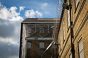 New anti-drone netting has been attached to the top of the large metal security fence to protect the prison grounds of  HMP Pentonville, London, UK. HM Prison Pentonville is an English Category B men's prison, operated by Her Majesty's Prison Service. Pentonville Prison is located on  Caledonian Road in the Barnsbury area of the London Borough of Islington, north London, United Kingdom. (Photo by Andy Aitchison)