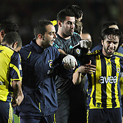 Fenerbahce's players (Left to Right) Semih SENTURK, goalkeeper Volkan DEMIREL,Gokhan GONUL celebrate victory during their Turkish superleague soccer derby match Galatasaray between Fenerbahce at the AliSamiYen Stadium at Mecidiyekoy in Istanbul Turkey on Sunday, 28 March 2010. Photo by TURKPIX
