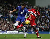 Photo: Lee Earle.<br /> Chelsea v Middlesbrough. The Barclays Premiership.<br /> 03/12/2005. Chelsea's John Terry (L) battles with Jimmy Floyd Hasselbaink.