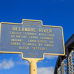 Matamoras, PA, USA - October 17, 2018:  A Delaware River Sign at the Mid-Delaware Bridge that carries U.S. Routes 6 and 209 across the river between New York and Pennsylvania.
